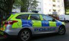 A police car outside Dallfield Court.