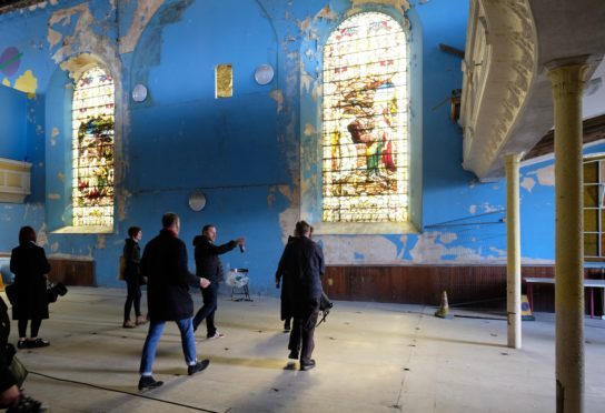 The team explore the historic church's magnificent stained glass windows
