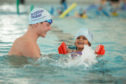 Duncan Scott - Olympic, world, Commonwealth and European swimmer -helps Yasmin Diraham, 4, improve her swimming style during his visit to Michael Woods sport and leisure centre, Glenrothes