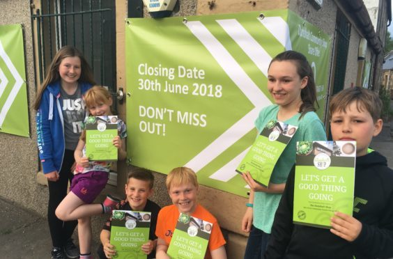 Children in Dunshalt are urging residents to buy shares in their local shop