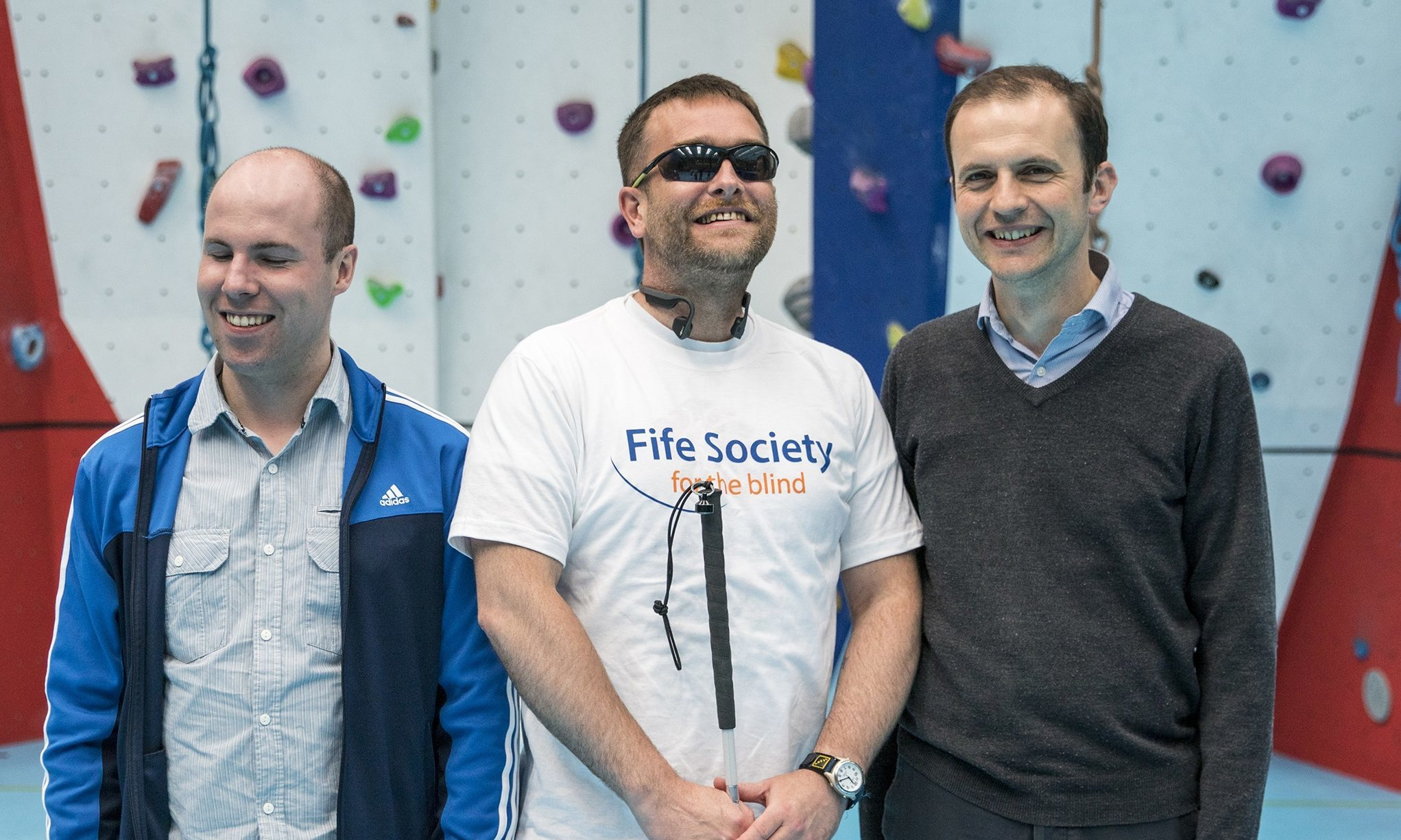 Garry Cowan (centre) with MP Stephen Gethins (right) and Stuart Beveridge, of Fife Society for the Blind