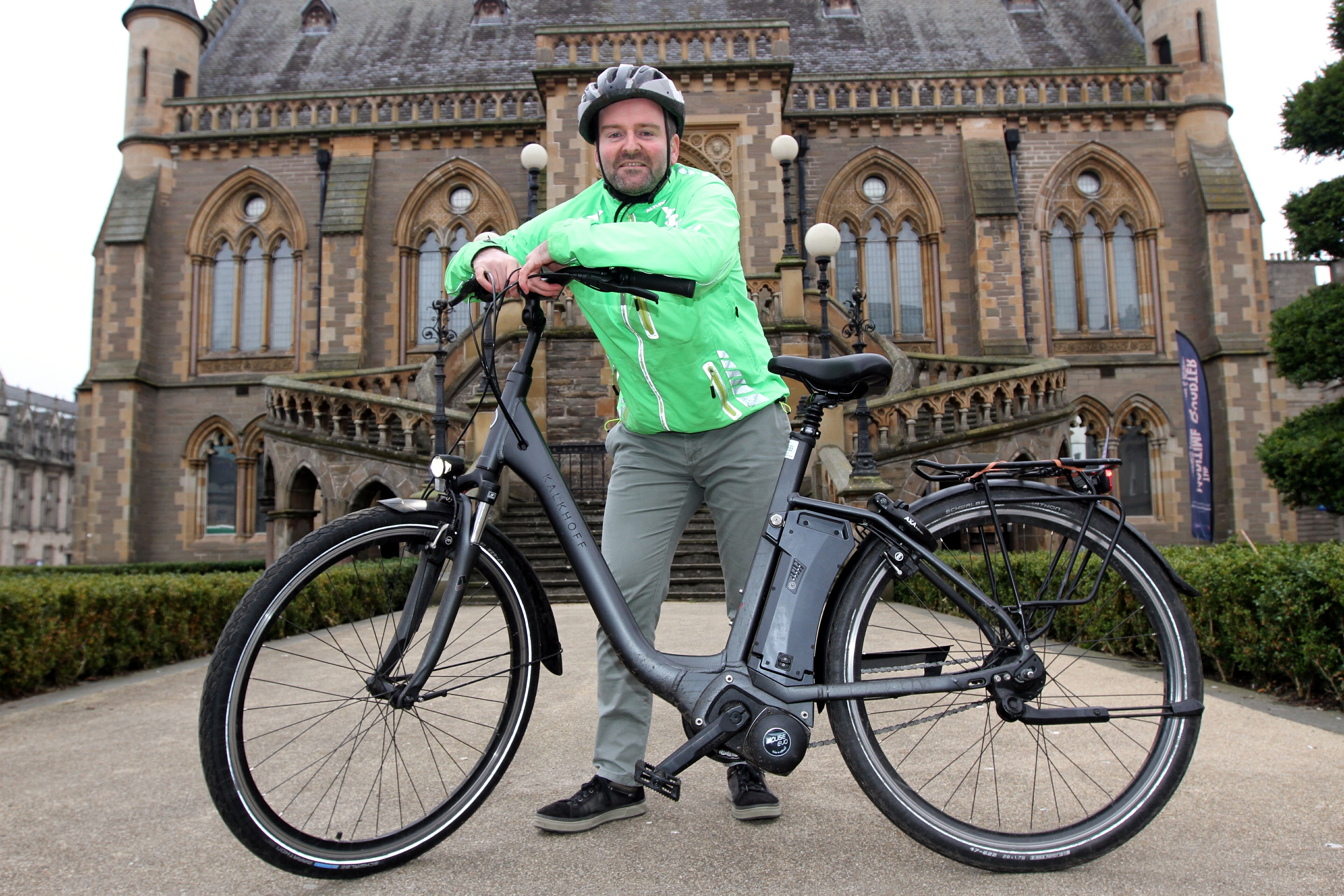 Richard Rooney with the e-bike he tested for a week.