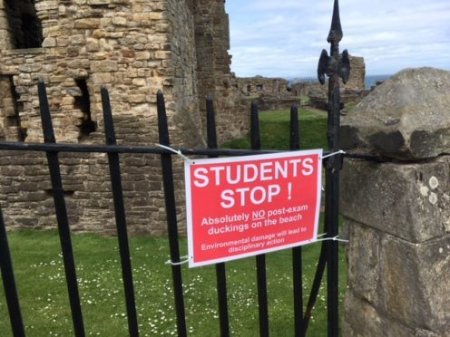 The sign warning students has gone up on fencing above Castle Sands.