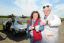 Donna 'Marty McFly' Henderson and David 'Dr Emmett Brown' Henderson with their DeLorean.