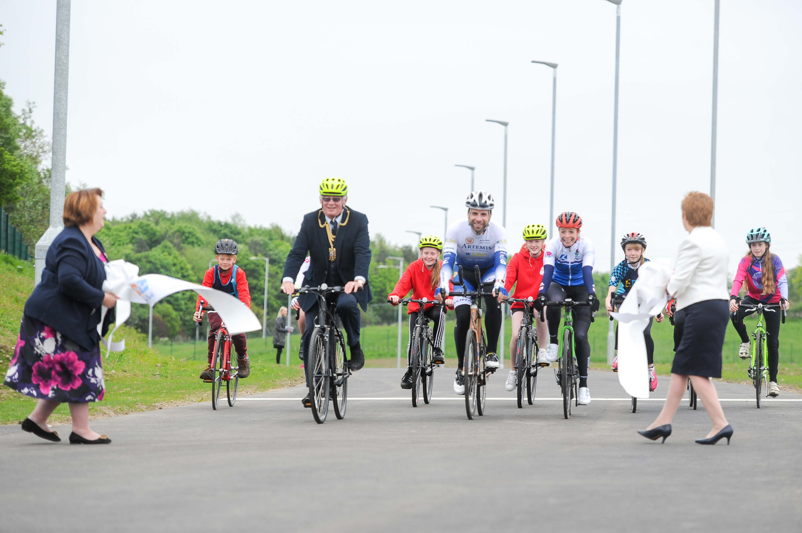 Some of the cyclists led by Provost Jim Leishman and Mark Beaumont burst through the ribbon to declare the park officially open.