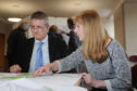 Euan Cameron discusses the plans with Jacquie Forbes, consulting architect for the project.