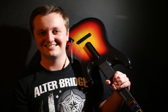 Jordan Siddalls took part in a 12-hour Guitar Hero session in memory of his step-father.