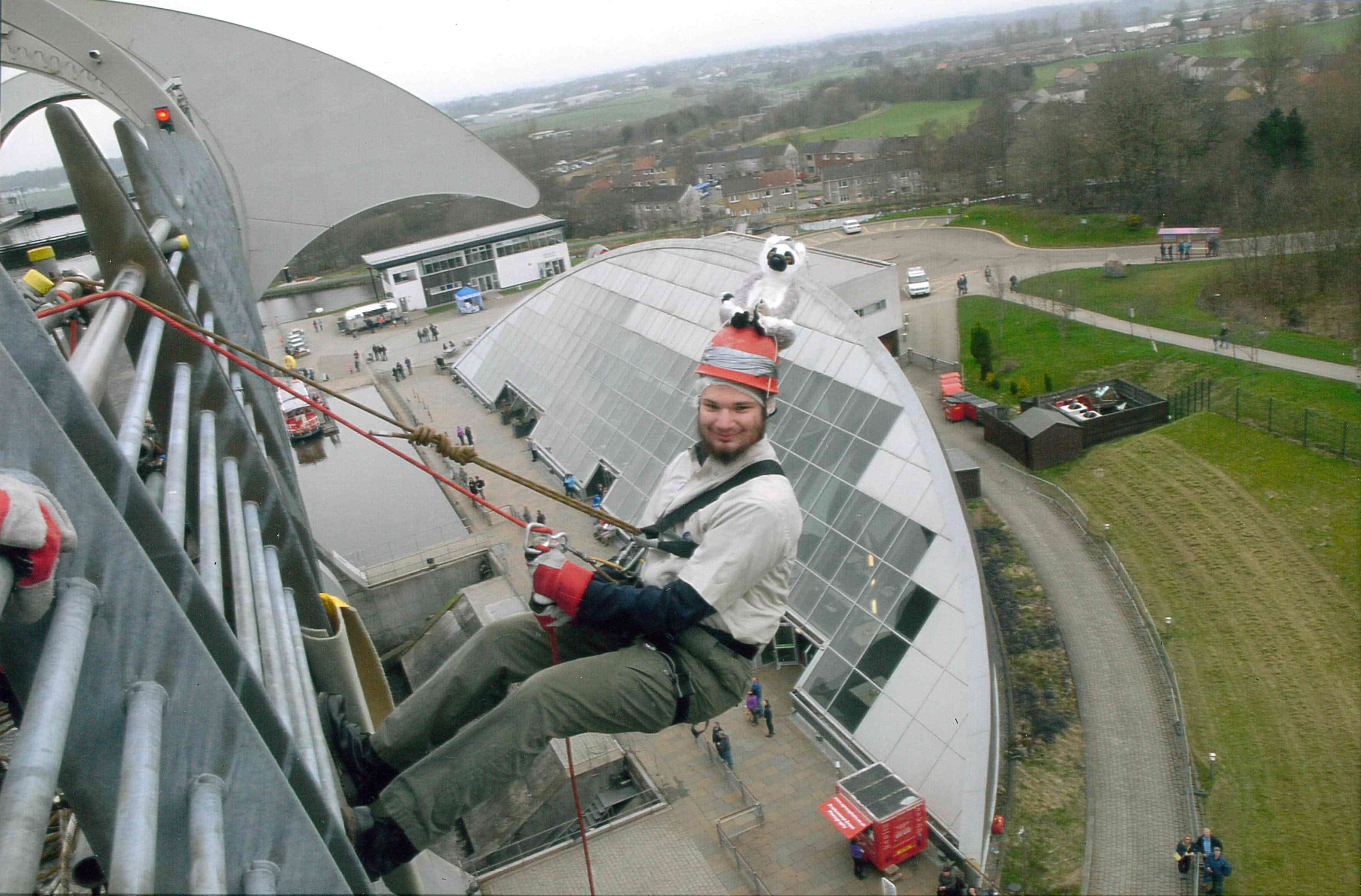 Kieran abseiled down the Falkirk Wheel to raise funds for his trip