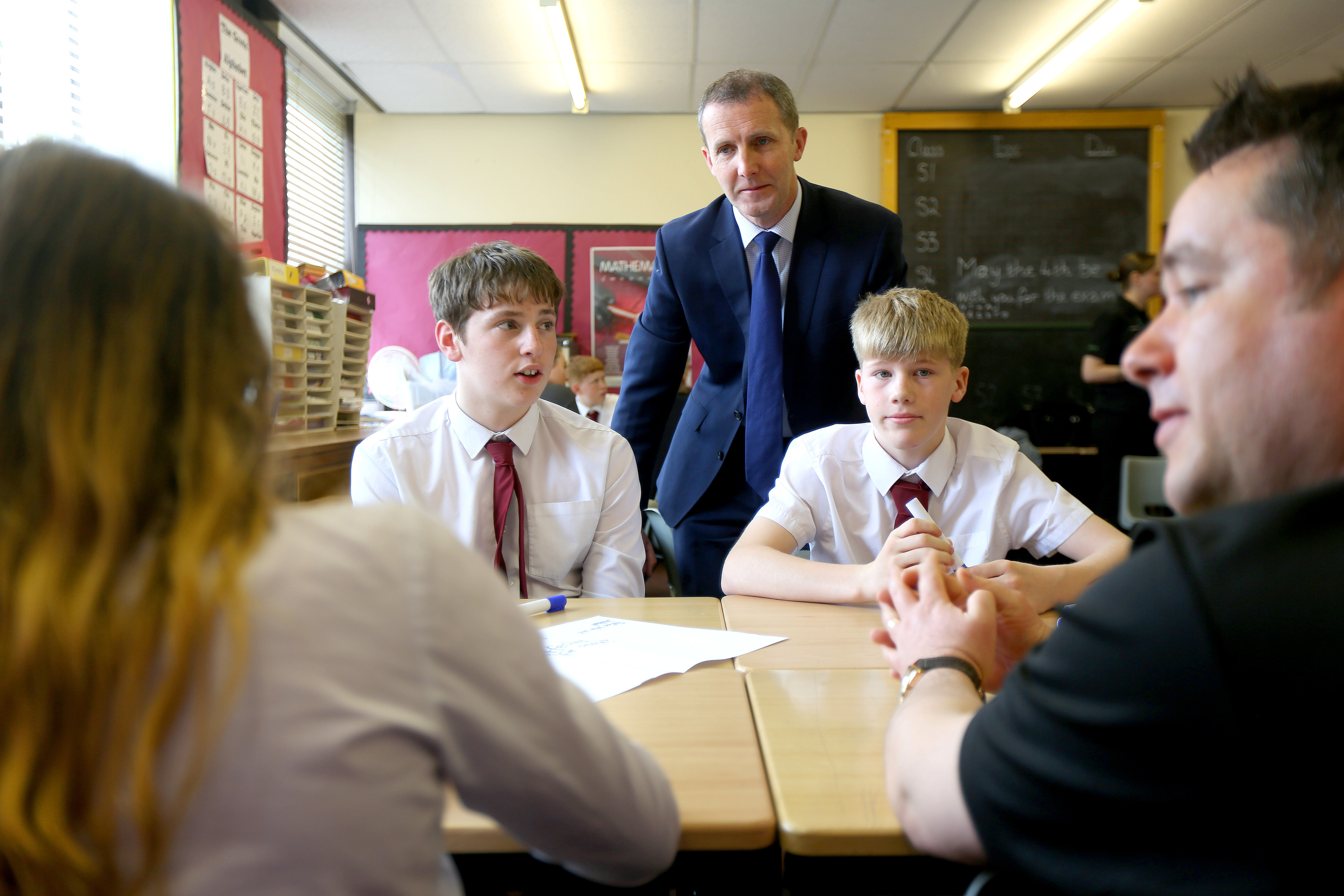 Justice Secretary Michael Matheson with Police Scotland youth volunteers and pupils, Bradley Williamson and Rory Hunter.