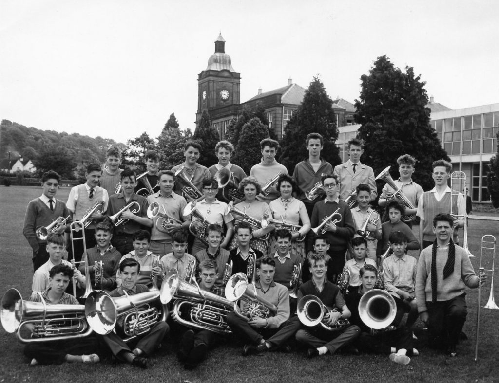 This is the National Youth Brass Band of Scotland in Kirkcudbright 1961 with John Wallace second row second from the left, John Miller third from left, Professor Sir David Wallace third row fourth from the left.