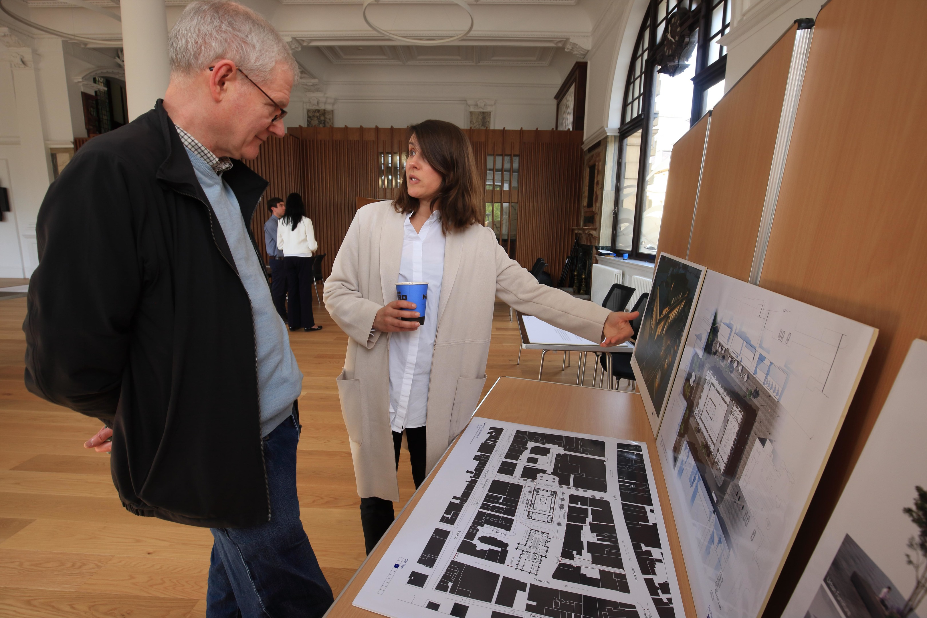 Local resident James Watt is shown the plans by architect Carmen Pereira of Mecanoo Architects.