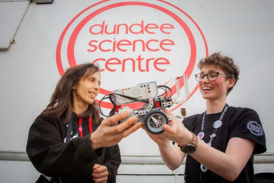 Science communicators Rachel Gillespie (left) and Emma Dixon with a Lego Mindstorm bot.