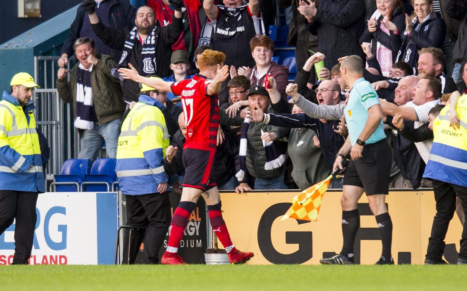 Simon Murray goes to celebrate his goal against Ross County with the travelling Dundee fans.