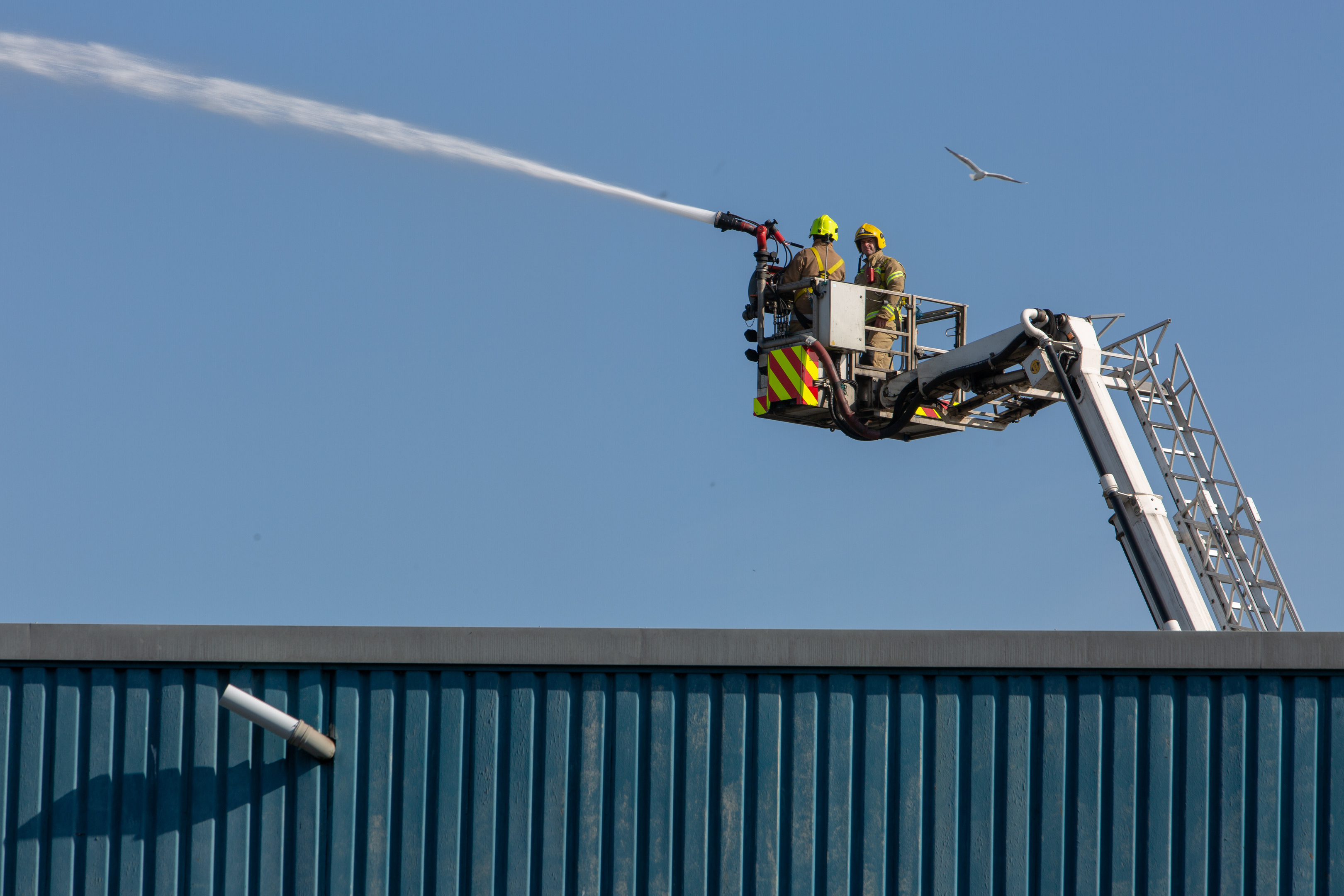 Fire damage and fire fighters on scene at Southfield Industrial Estate.