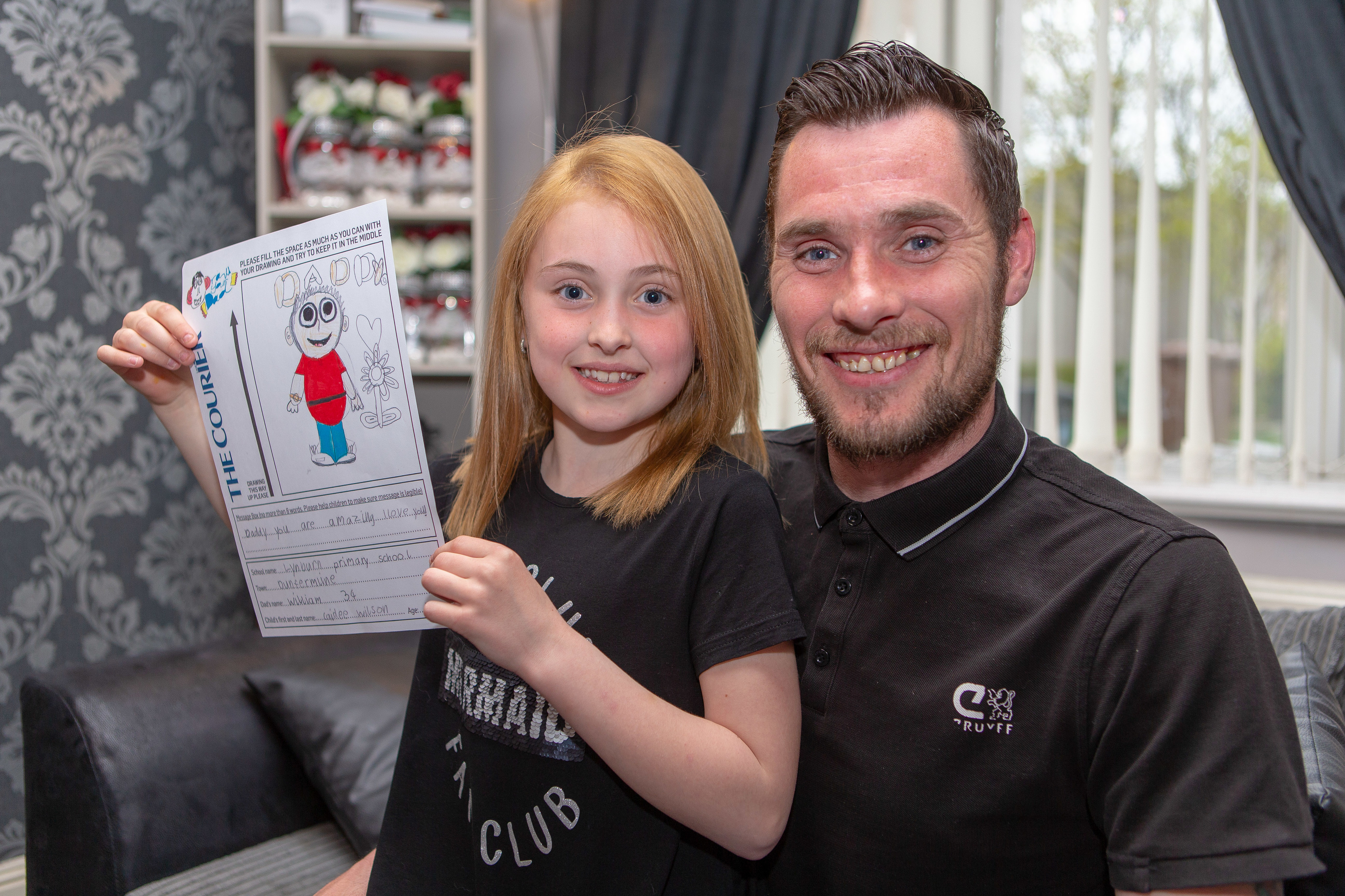 Caidee Wilson with dad William Wilson at home in Dunfermline.