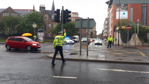 Police Scotland officers called in to direct traffic in West Marketgait, Dundee.