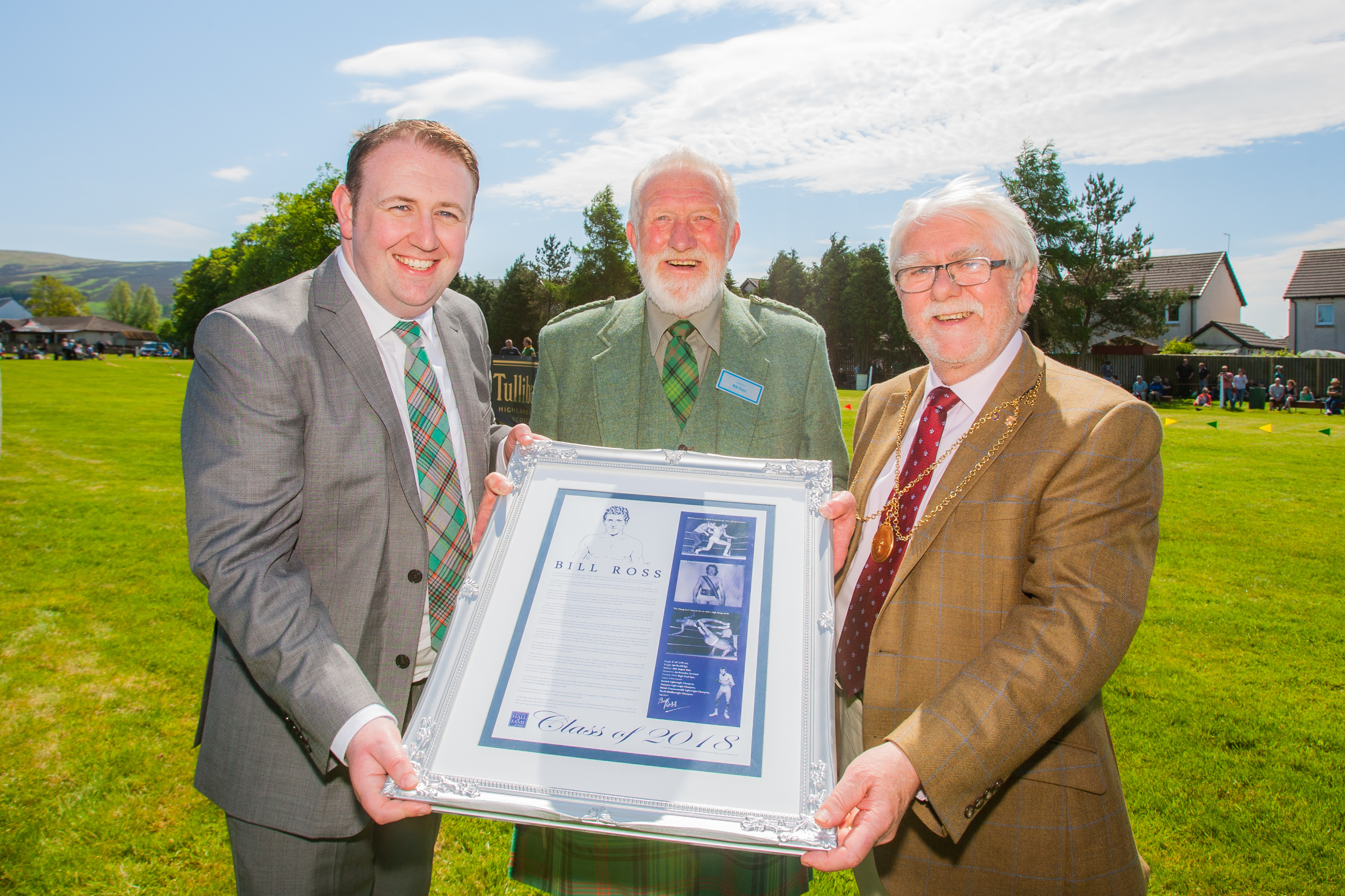 Auchterarder wrestler Bill Ross was inducted into the Professional Wrestling Hall of Fame. From left:, Hall of Fame founder Bradley Craig, Bill Ross and Provost Dennis Melloy.