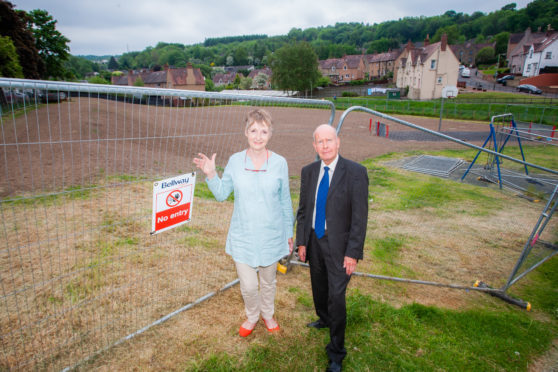 Campaigner Liz Barrett and Councillor Willie Wilson at the fenced-off park.