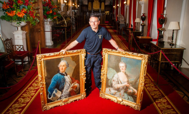 Two paintings by Marcello Bacciarelli to be transported to Warsaw for special exhibition. Picture shows Scone Palace curator Graham McIntyre with the two paintings, left is David 7th Viscount Stormont (Afterwards 2nd Earl of Mansfield) and right is Henrietta Countess Bunau 1st Wife of David 7th Viscount Stormont.