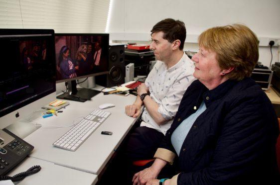 Adam Lockhart and Linda Gellatly looking at the footage