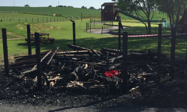 The burnt-out children's wigwam at the adventure park.