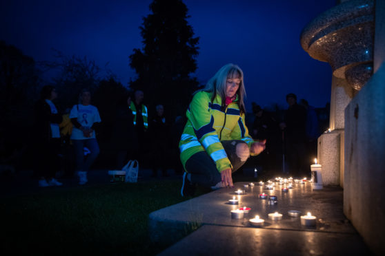 Tracy Swan, who lost her daughter to suicide, led the torchlight walk through Perth.