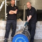 Scott Stewart and Ali Fisher filling the first cask for the Ardnamurchan Trust
