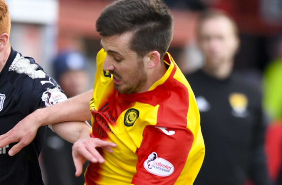 Callum Booth in action against Dundee.