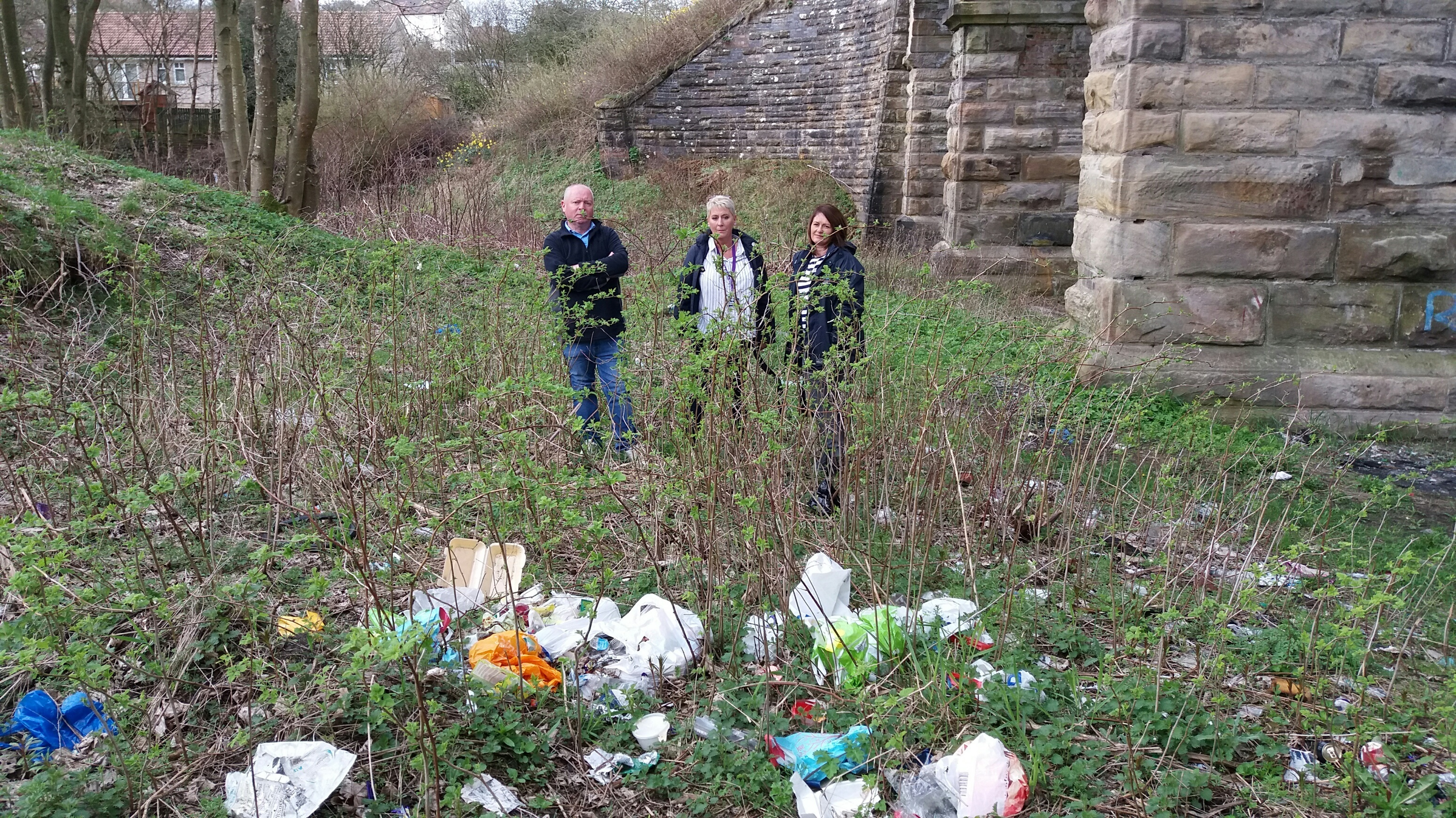 Dave Roy, Councillor Liewald and Catriona Henderson of the community payback project inspect the mess