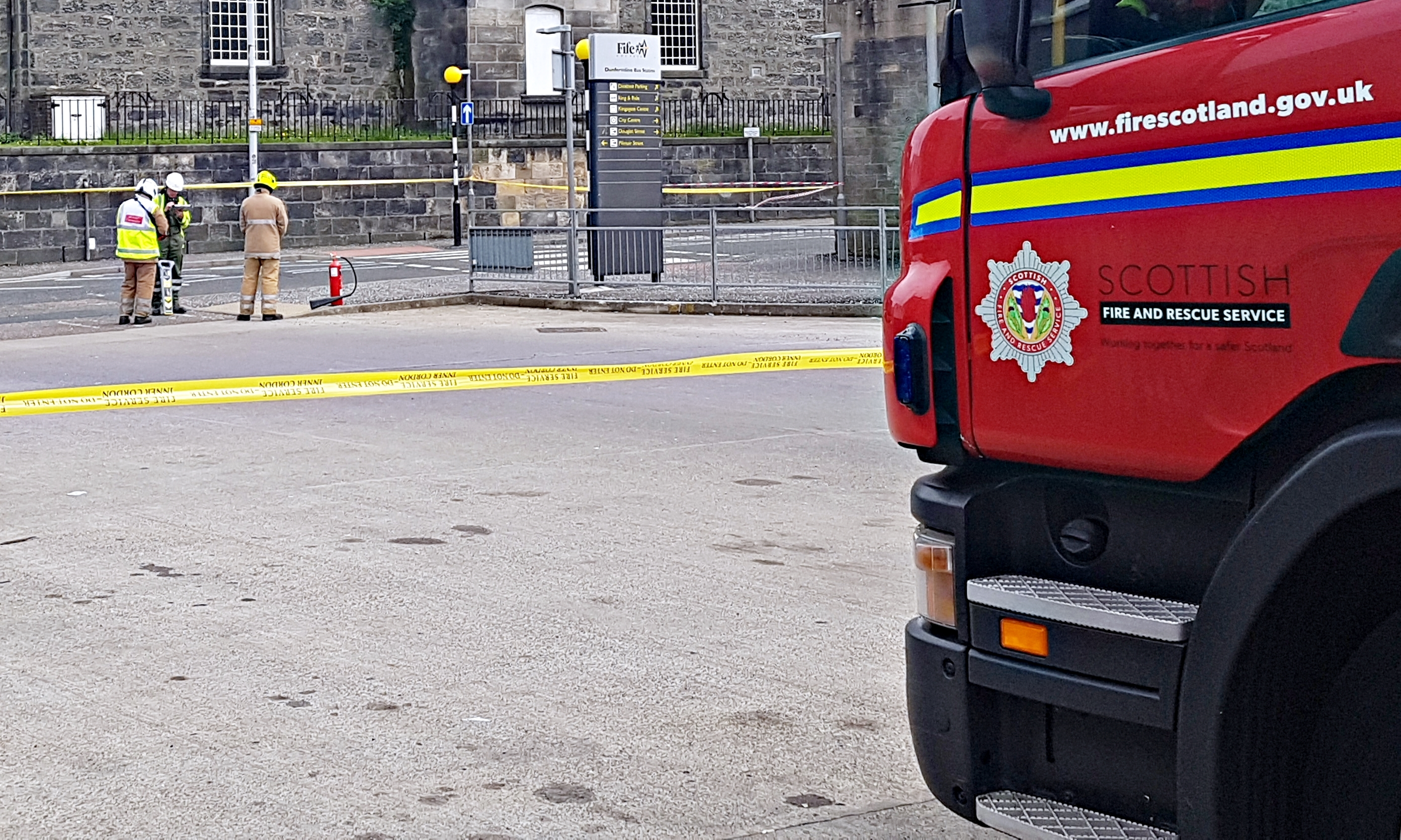 Firefighters investigating the explosions at Dunfermline Bus Station.