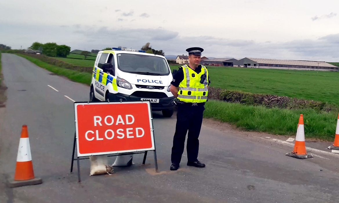 The road has been closed while police investigate the circumstances of the woman's death.