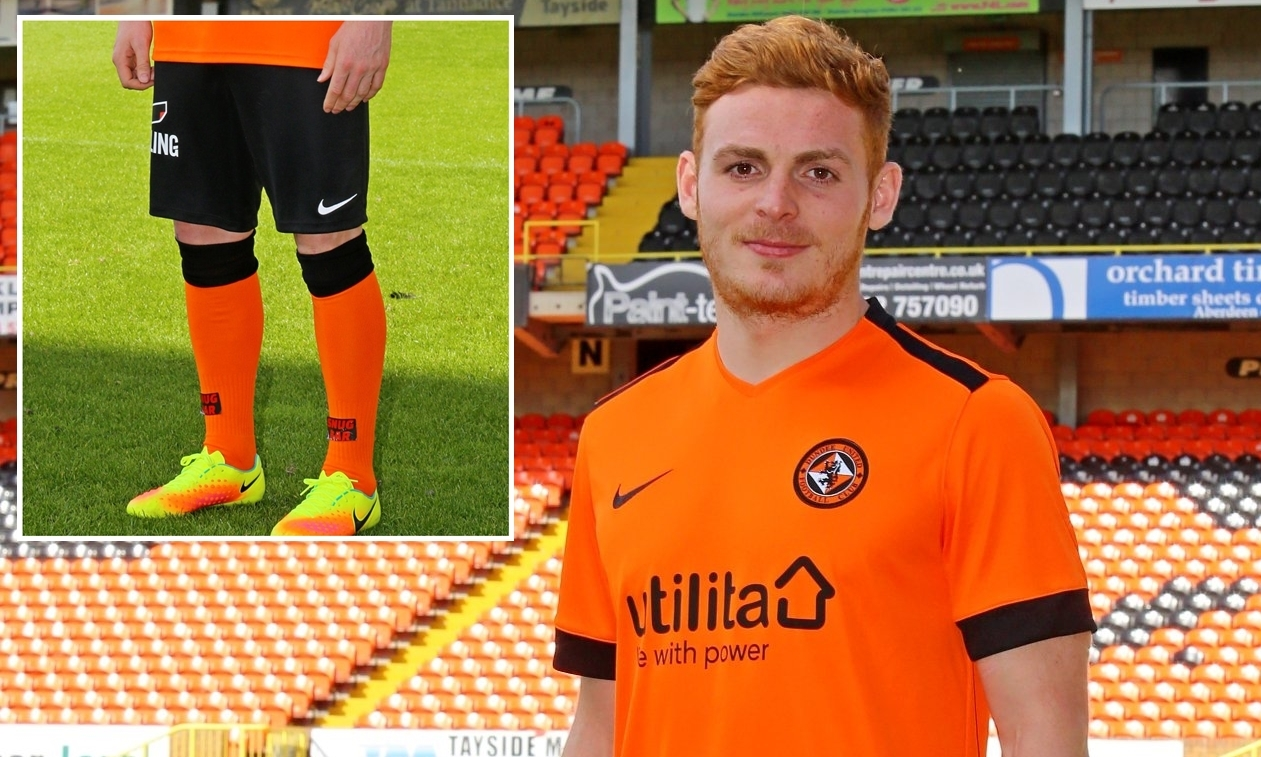 Fraser Fyvie, who has signed a new deal with the club, models next season's home strip — complete with black shorts.