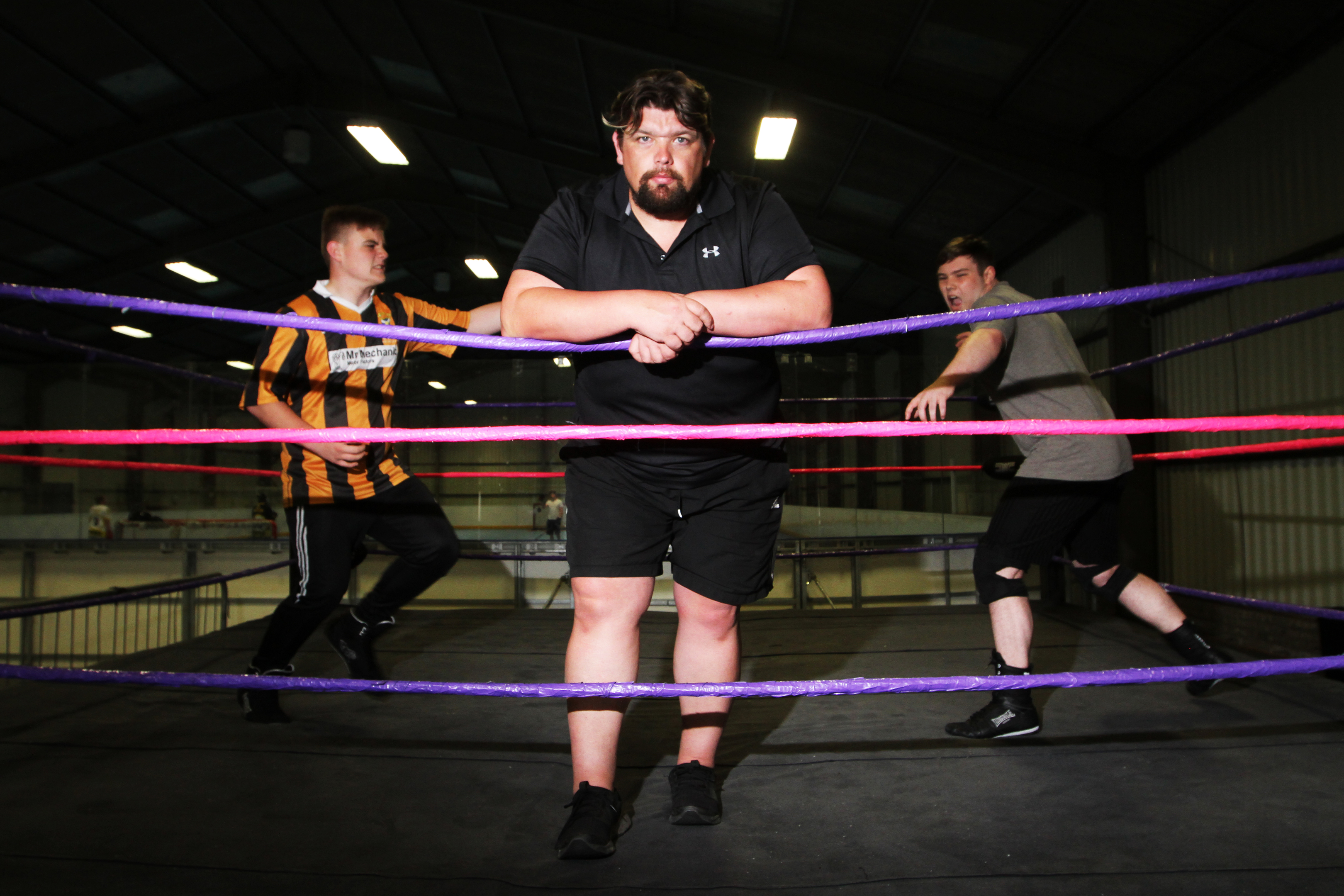 David Low, head trainer for SWE, with trainee wrestlers Kerr Davie and Brandon Tierney.