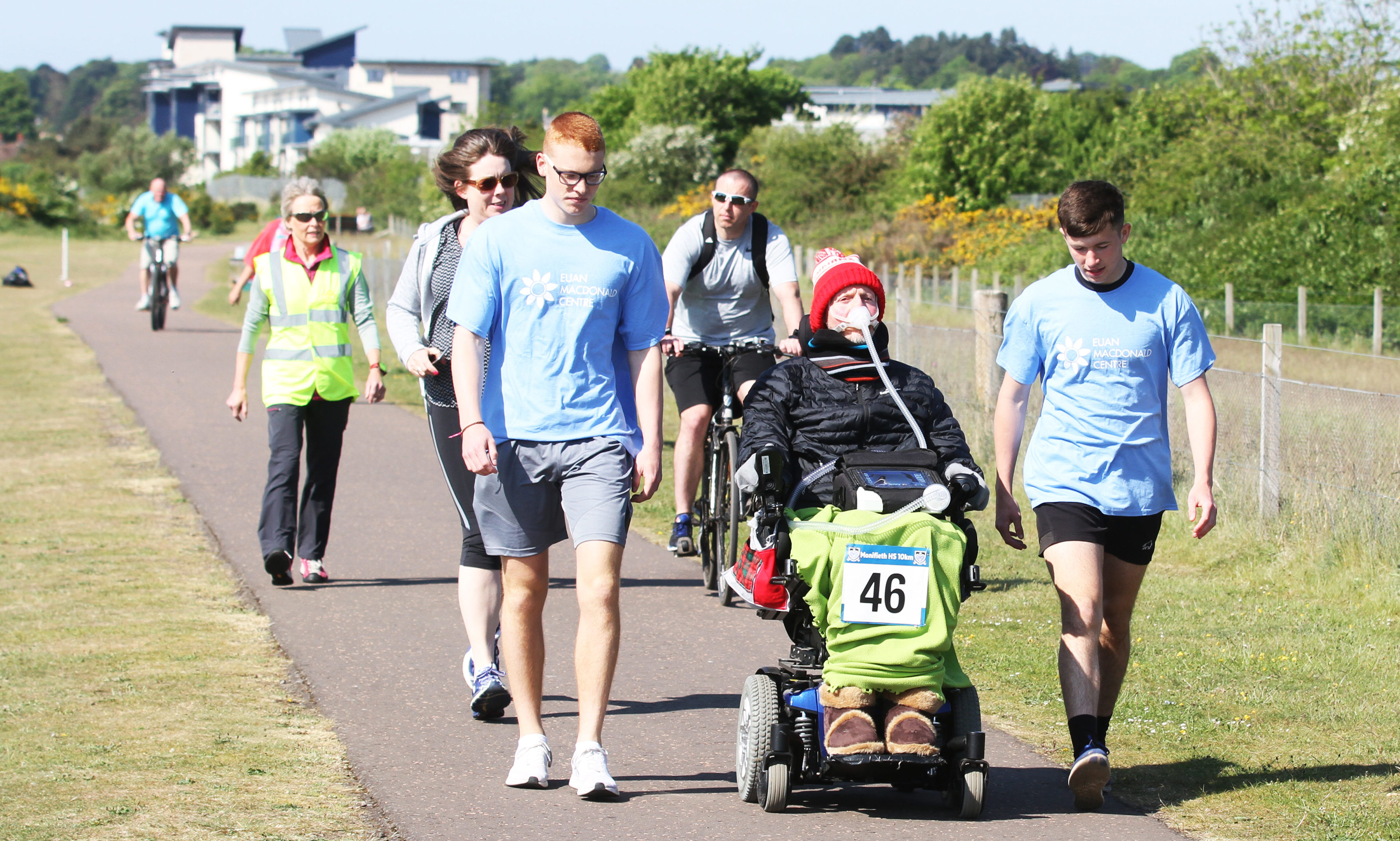 Donald Grewar taking part in the 10k with school captains Jacob Dempster and Ryan Docherty.