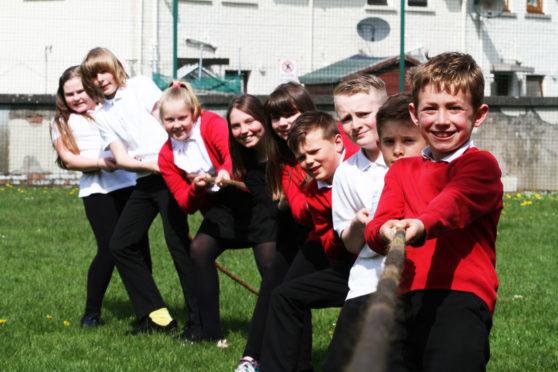 The kids at Newtyle Primary School enjoying their tug o' war games.