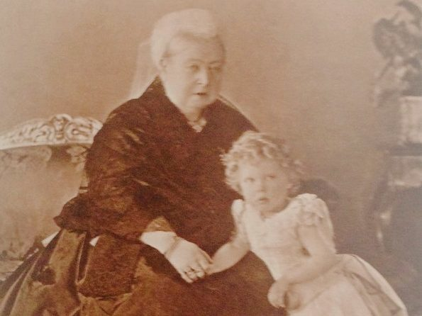 Queen Victoria wearing the dress (or similar) with her great grandson, Prince Edward, later King Edward VIII.