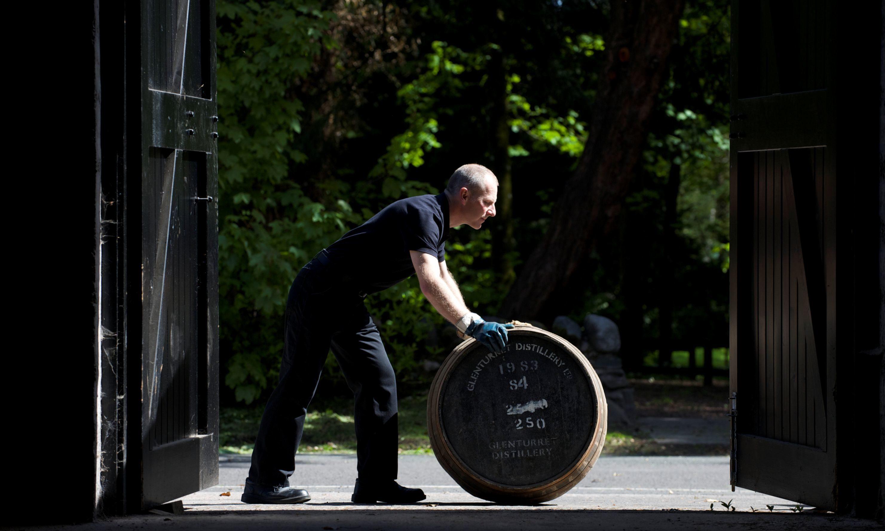 Rolling a cask at the Glenturret Distillery