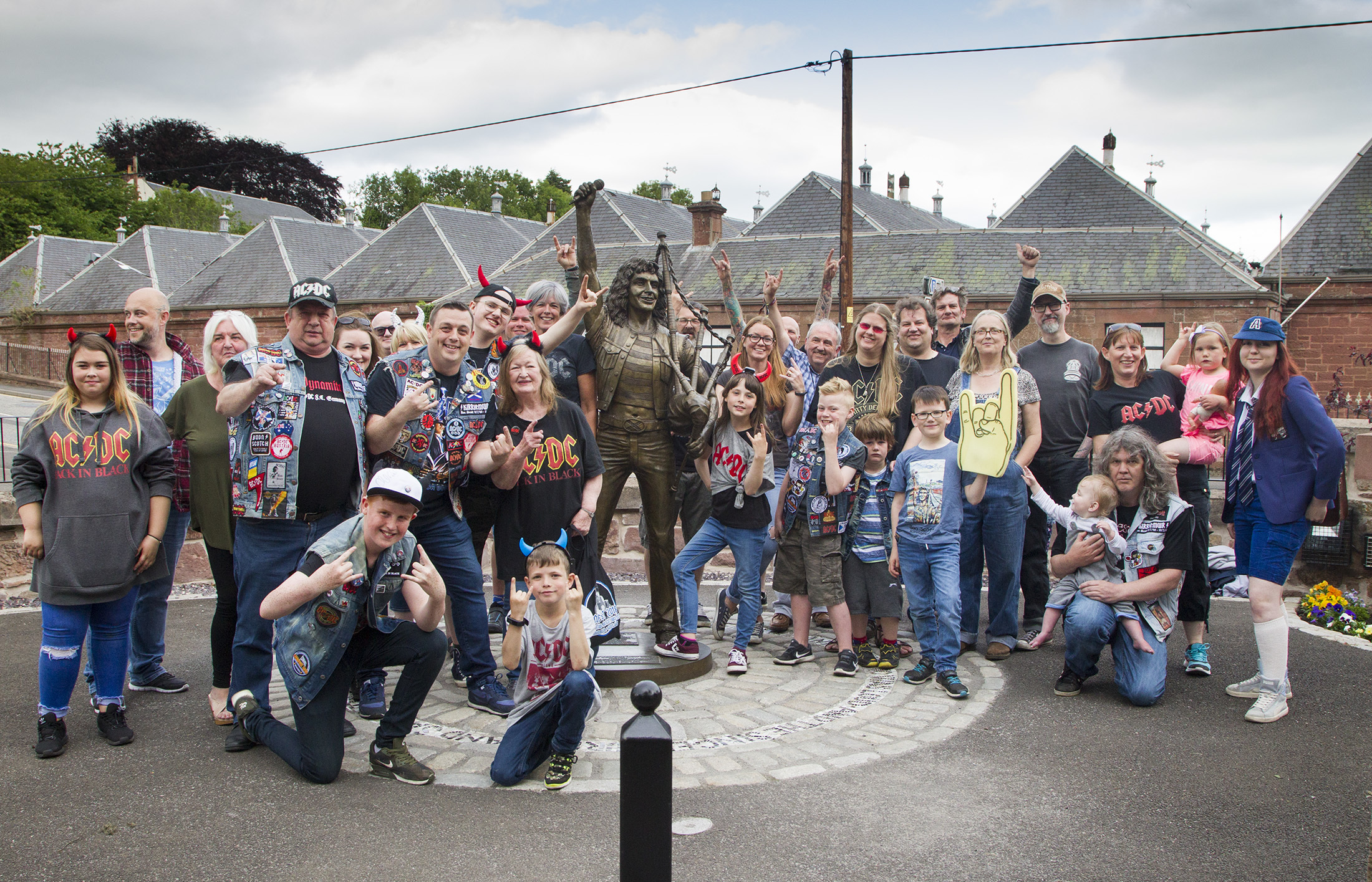 AC/DC fans at the Bon Scott statue in Kirrie.