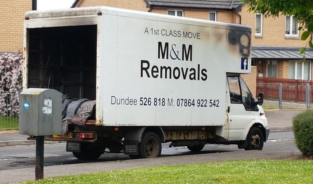 The fire damage to Mark's removal van.