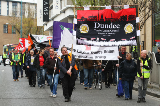 Trade Unions marching through Dundee's city centre at a recent event.