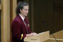 Abby Lang, head girl at Harris Academy in Dundee, delivers her Time for Reflection speech at the Scottish Parliament.