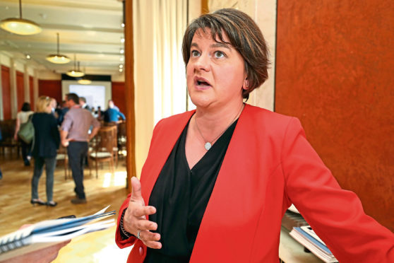 """DUP Leader Arlene Foster speaks to the media at Stormont Parliament in Belfast, following her comments at the weekend about the partys """"red line"""" on customs arrangements post-Brexit, which were interpreted by some as a veiled threat to pull the plug on her party's confidence and supply deal with the Tories. PRESS ASSOCIATION Photo. Picture date: Monday June 4, 2018. Mrs Foster has denied threatening the Prime Minister over Brexit, insisting she does not think Theresa May would even consider a deal that would treat Northern Ireland differently. See PA story POLTICS Brexit Foster. Photo credit should read: Niall Carson/PA Wire"""