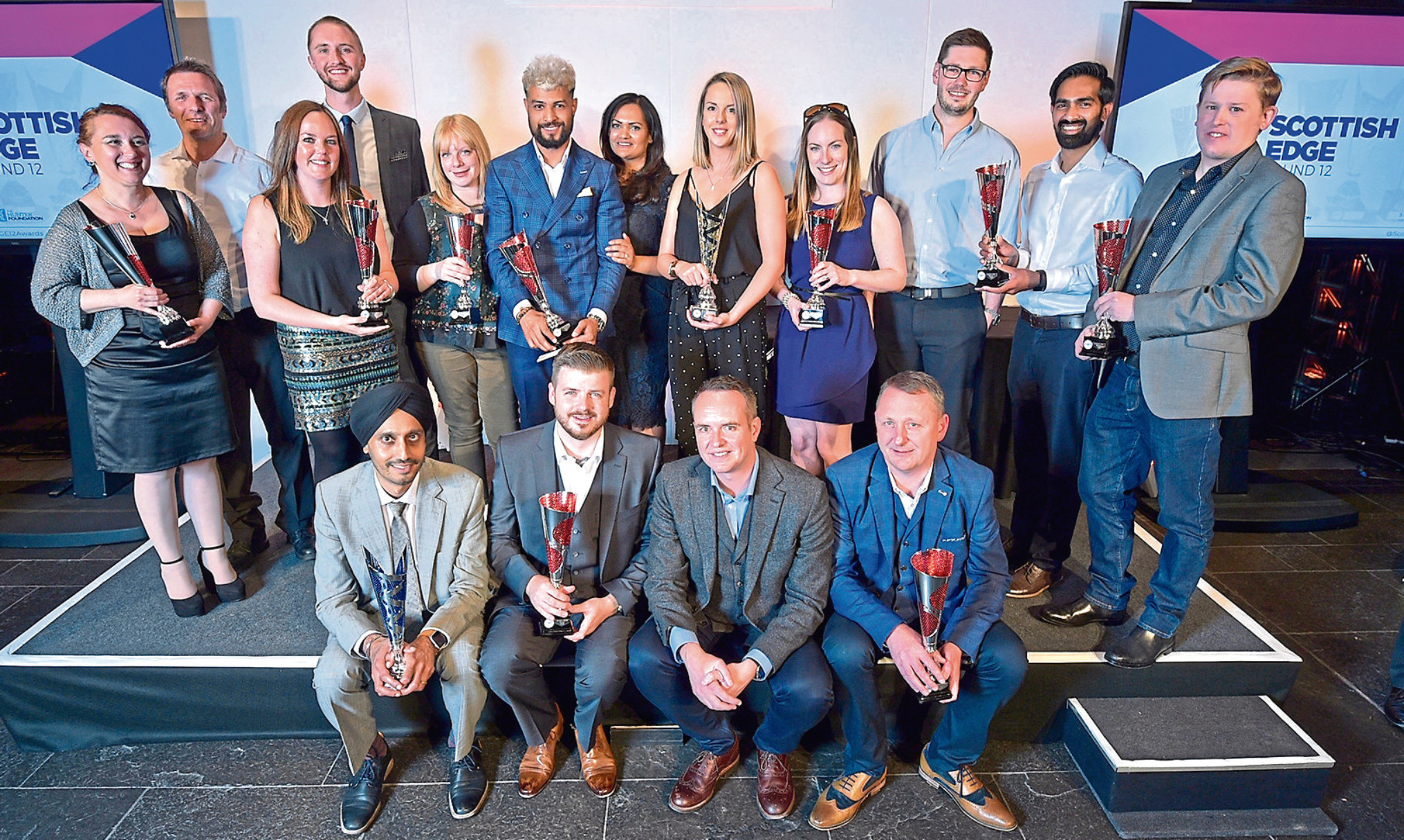 Some of the Scottish EDGE 2018 winners including (seated, centre front) Jamie Shankland, founder of Just Venue and Broker Insights chief executive Fraser Edmond.