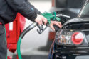 Undated file photo of driver putting petrol in a car. See PA Feature MOTORING Column. Picture credit should read: PA. WARNING: This picture must only be used to accompany PA Feature MOTORING Column.