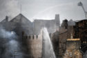 Fire fighters battle a blaze at the Glasgow School of Art for the second time in four years on June 16,