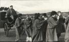 Clement Freud being hauled over the Tay Road Bridge in a carriage by students of Dundee University in 1977.