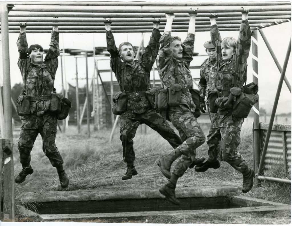 Barry Buddon Assault Course. Photograph showing men of A Company, 1st Battalion, Black Watch, 51st Highland Volunteers, on the assault course during the TA Competition at Barry Buddon. December 3 1983.