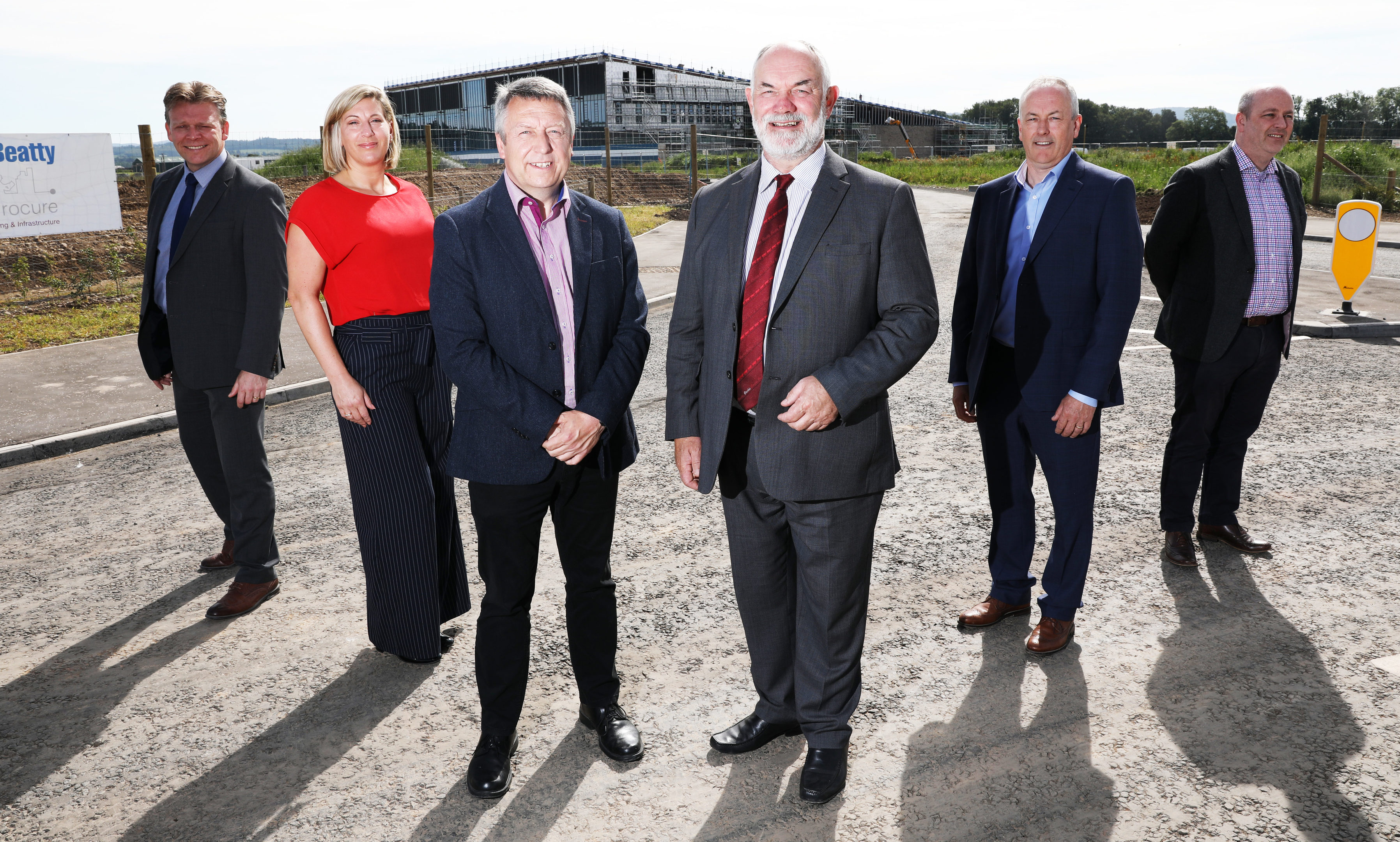 The official opening of the new link road to Bertha Park.  Picture shows; Bertha Park Head Teacher Stuart Clyde, Victoria Bramini from Scape,  Councillor Angus Forbes, Council Leader Murray Lyle, Hector MacAulay and Graeme Dickie from Balfour Beatty on the new road link beside the new school.