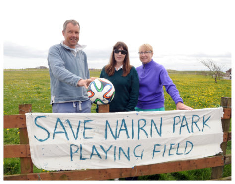 Community council member Angus Meldrum to pose in front of under threat kids football pitch in Elie ltr Angus Meldrum, Carol Birrell, Sandy Bingham