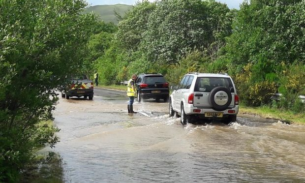 Motorists struggling on the flooded A823 on Monday evening.